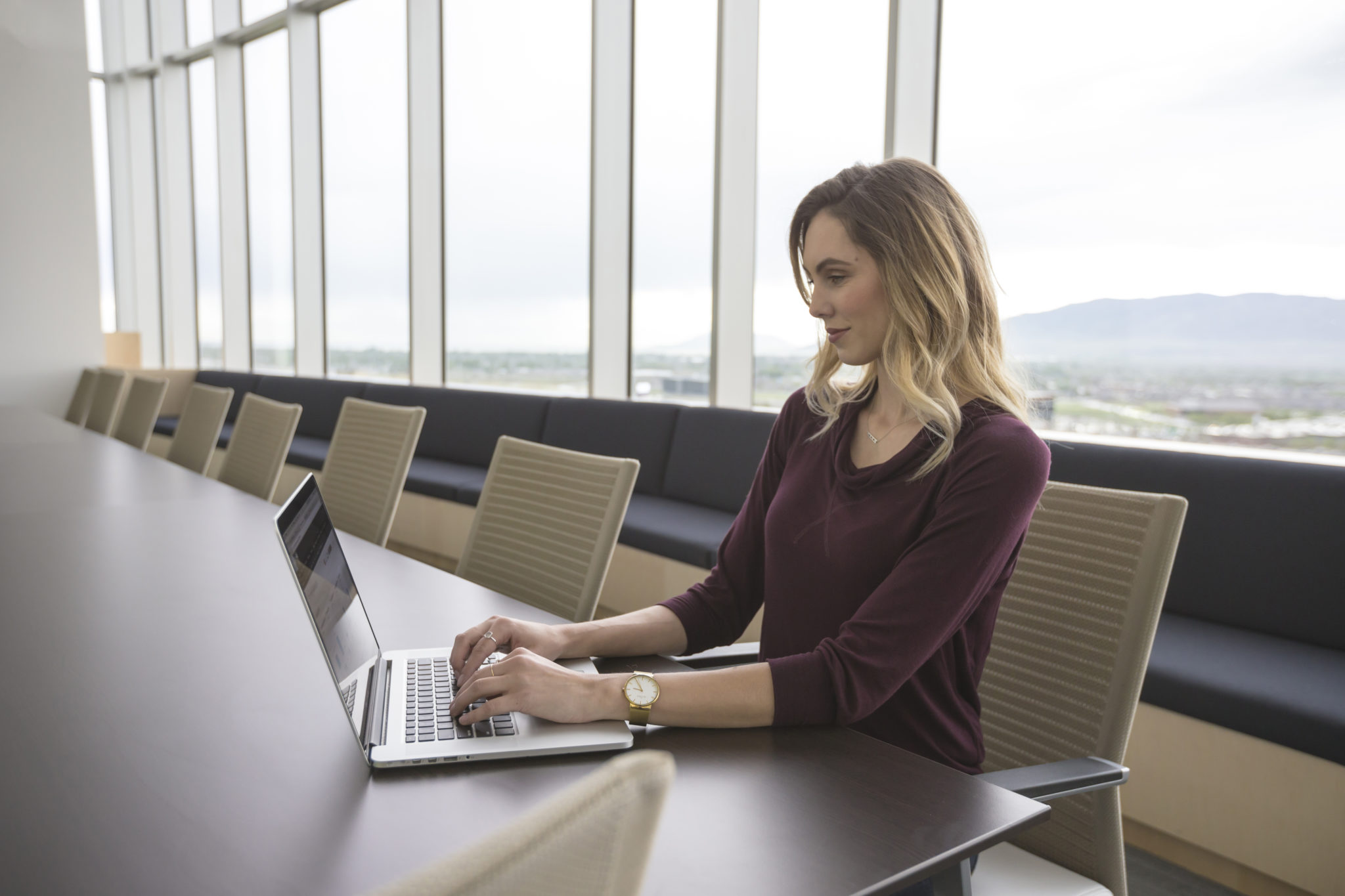 Lady in office typing on laptop